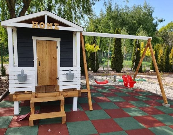 Plac zabaw domek huśtawka ścianka wspinaczkowa bocianie gniazdo