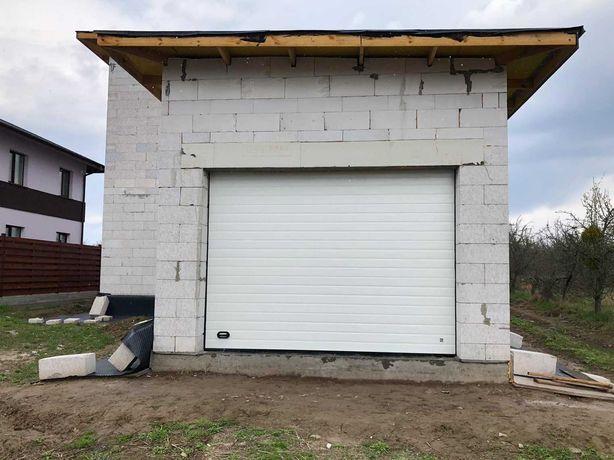 Подъемные ворота на гараж. Секционные и роллетные гаражные ворота