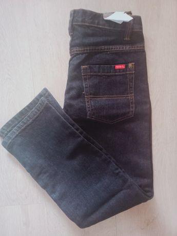 Nowe spodnie dziecięce Name It 146 cm