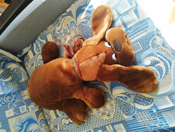 Продам мягкую игрушку собаку,состояние идеальное.Длина 55 см.