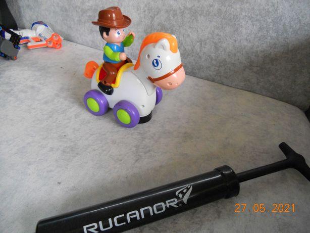 электромеханическая игрушка ковбой