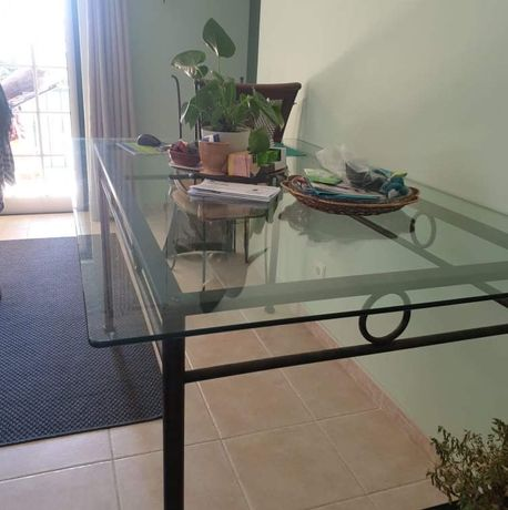 Mesa de vidros com cadeiras