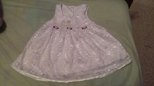 Нарядное платье на малышку.новое