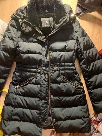 Продам теплую новую курточку