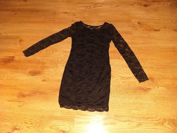 Sukienka  dla dziewczynki rozmiar 134.
