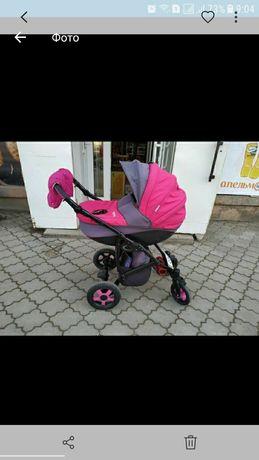 Продам коляску для девочки яркая