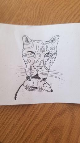 Рисунок тигрицы на листке бумаги.
