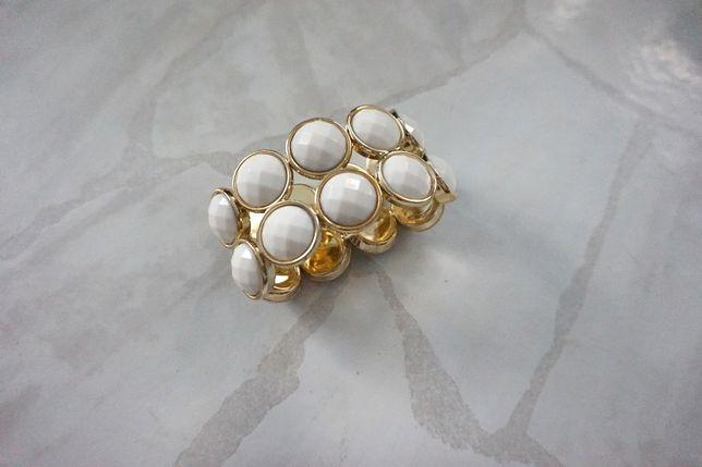 Piękna elegancka złota bransoleta z białymi kamieniami