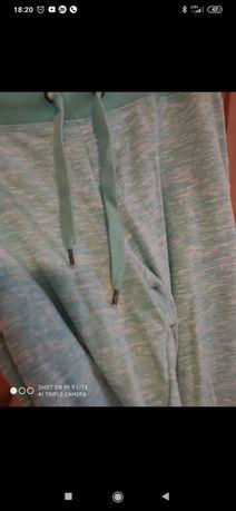 Miętowe nowe spodnie 46