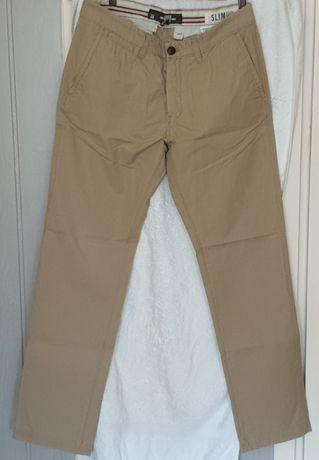 Spodnie męskie H&M,stan idealny, kremowe
