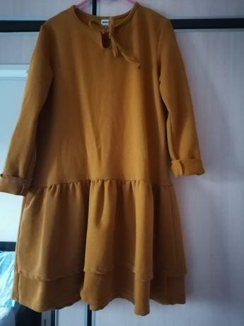 Sukienka r 140 starcza dłużej