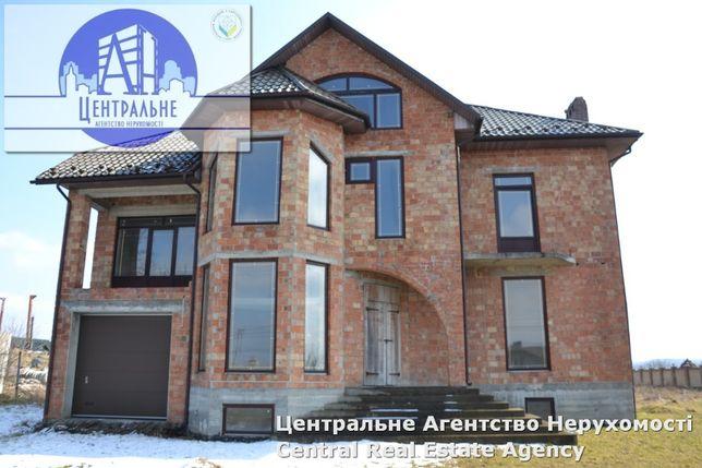 Продаж будинку неподалік міста