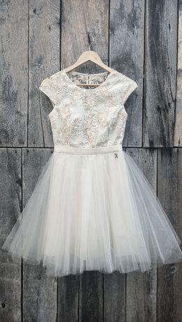 Beżowa balowa sukienka z tiulem