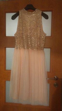 Elegancka sukienka 44-46