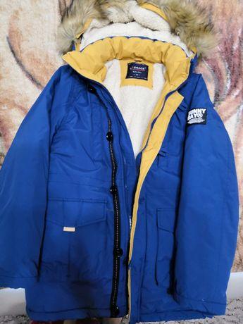 Продам курточку зимову на підлітка 13-14 років