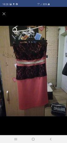 Sukienki raz użyte