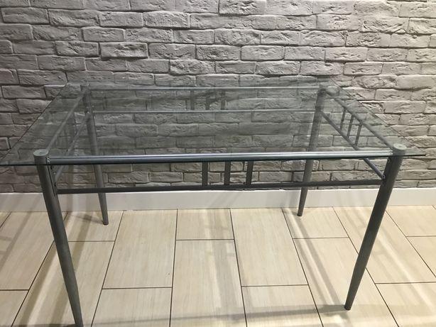 Sprzedal szklany stół
