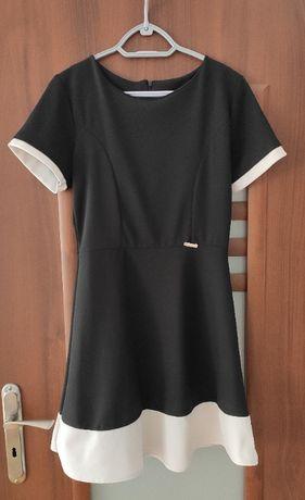 Śliczna rozkloszowana sukienka M L