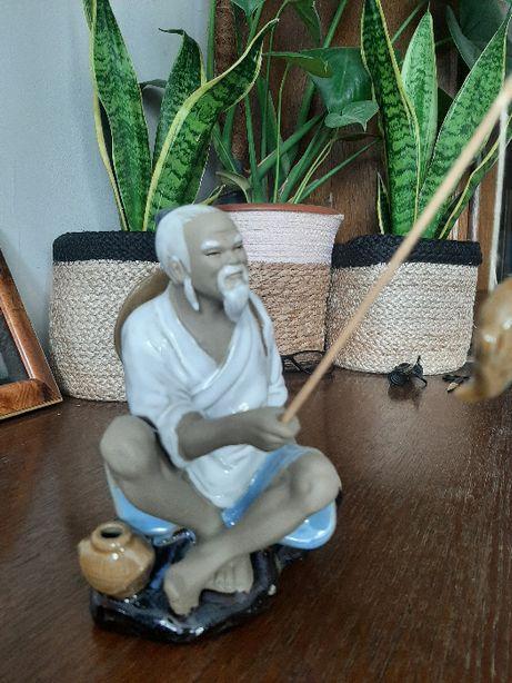 """Figurka porcelanowa """"Mężczyzna łowiący ryby"""""""