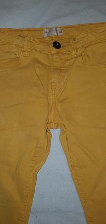 Jeansowe chłopięce spodnie jeansy Zara 7 lat 122 cm k. musztardowy.