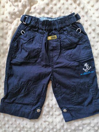 Granatowe spodnie chłopieńce roz 74 z regulowaną nogawką