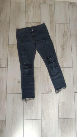 Spodnie rurki Esmara dziury rozdarcia M