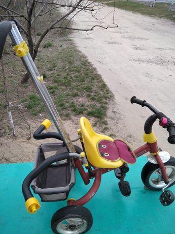 Велосипед трехколесный с ручкой и педалями