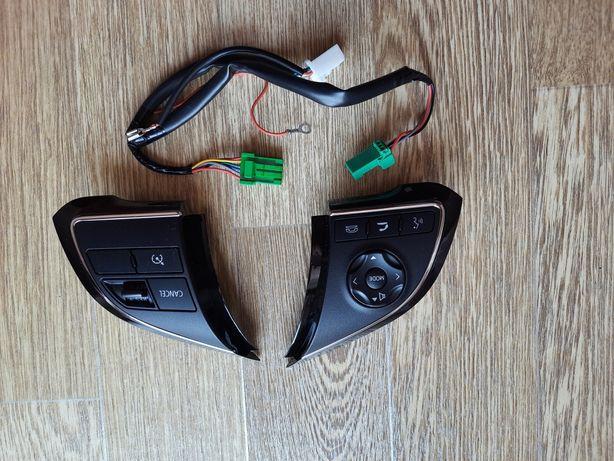Кнопки управления на руле Mitsubishi Outlander