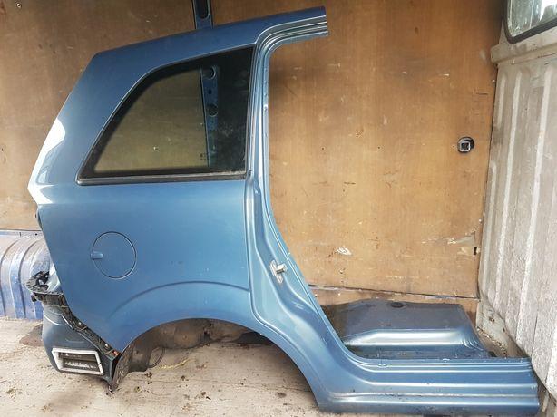 Opel Zafira B blotnik ćwiartka prawa tył tylna Z21B