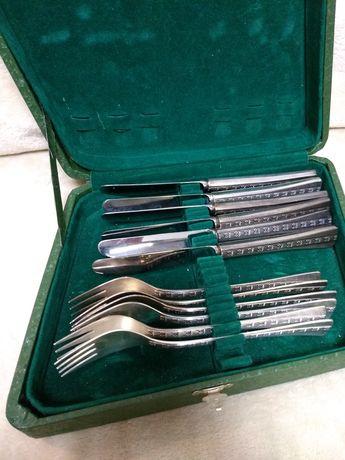 Продам столовый набор серебряных ножей и вилок
