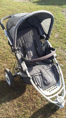 Дитяча коляска на 3 колеса розкладна Quinny.