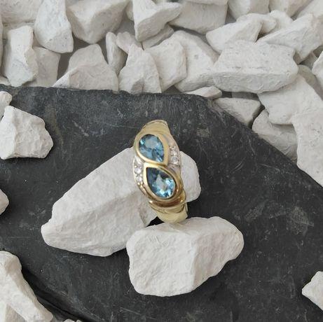 Złoty pierścionek z akwamarynem i brylantami (585)