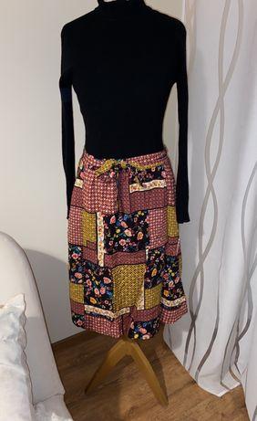 Nowa spodnica midi L