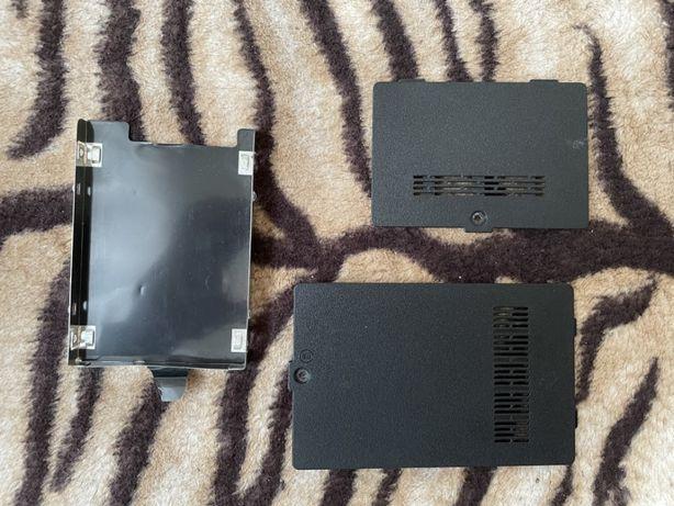 Zaslepki pamieci RAM i dysku twardego oraz tacka dysku twardego - tosh