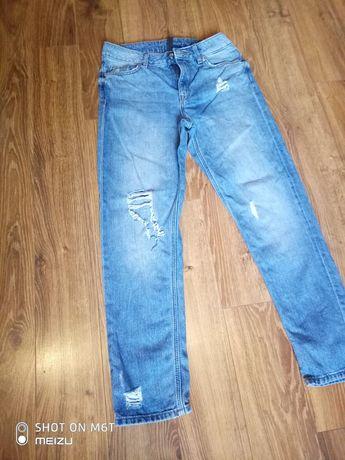 Spodnie dżinsowe z rozdarciami