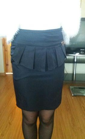 Школьная юбка синего цвета на возраст 9-11 лет.