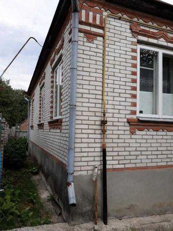 Продам дом с удобствами в центре Змиева