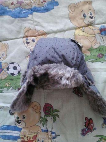 продам новую шапку на девочку зима