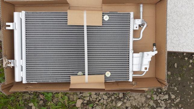 Радиатор кондиціонера Опель Opel Astra G,H,J Zafira A/B VectraC Зафіра