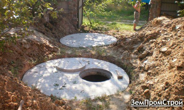 Выкопать канализационный колодец с переливом. Бетонные кольца
