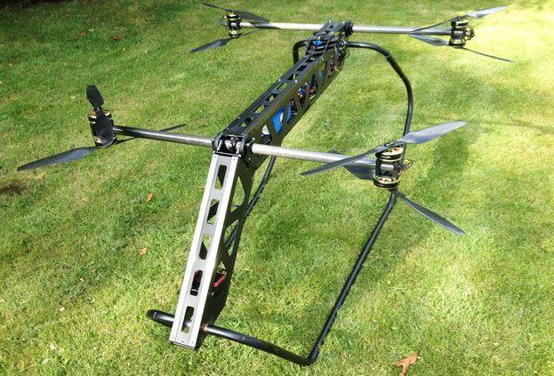 Грузовий дрон коптер квадрокоптер беспилотник для доставки груза видео