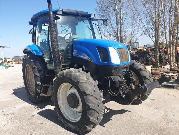 Trator-New Holland T6020 C/HID.FRONTAL em bom estado