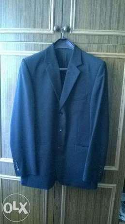 Elegancki w 100% z wełny męski garnitur marki New Men