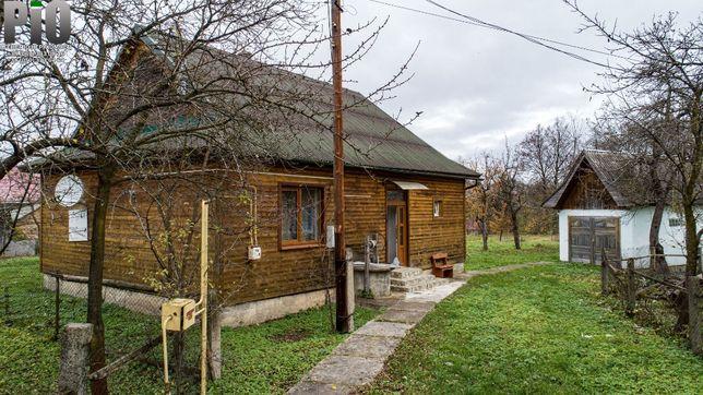 Продається житловий будинок із земельною ділянкою