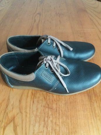 Туфли нові,шкіряні.