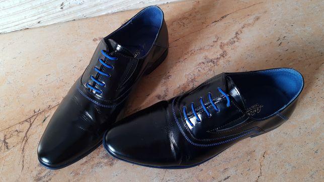 Oddam buty garniturowe za paczkę pampersów