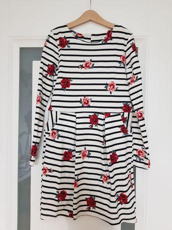 Śliczna sukienka H&M na komunię 140