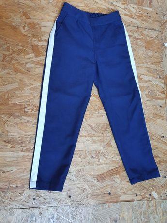 Spodnie Reserved rozmiar 134