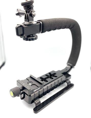 Uchwyt stabilizujący do bezlusterkowca, telefonu lub kamery sportowej.