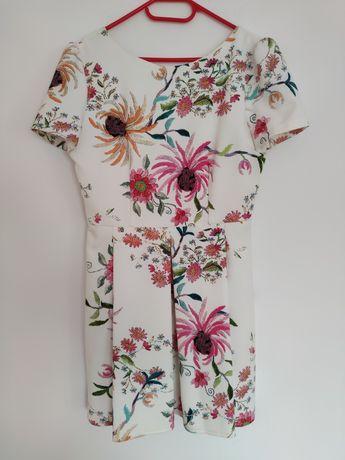 Wiosenna elegancka sukienka w kwiaty z paskiem - r. 42